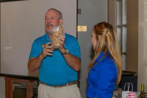 Past President Jepp Walter with Secretary Mallory Williams doing the auctions